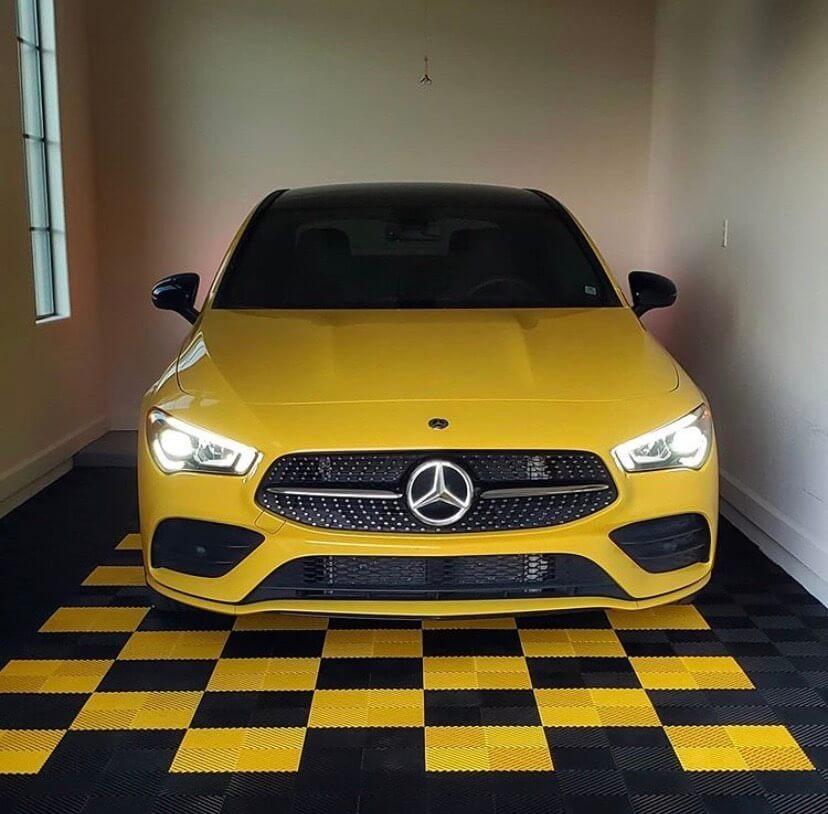 Yellow Mercedes Benz on Black and Yellow Garage Floor Tiles