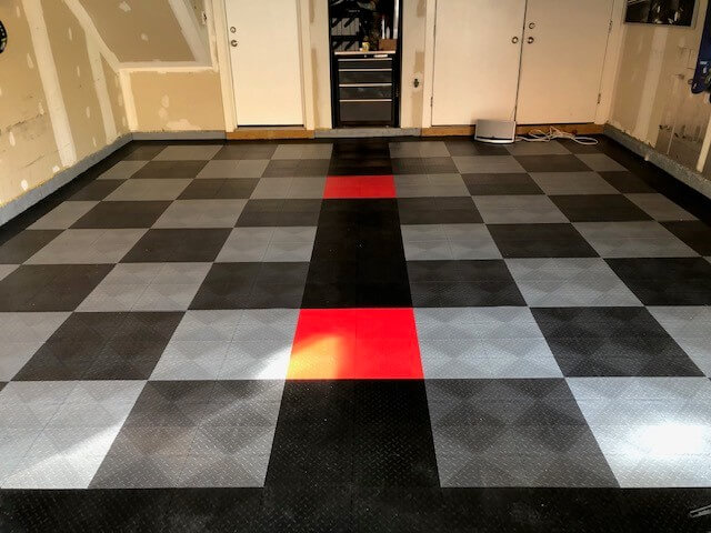 Black, grey, alloy, and red garage flooring pattern