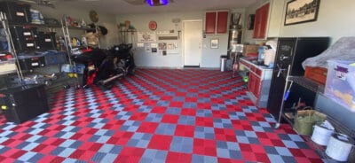 James' Red and Silver Ribbed Garage with motorcycle.