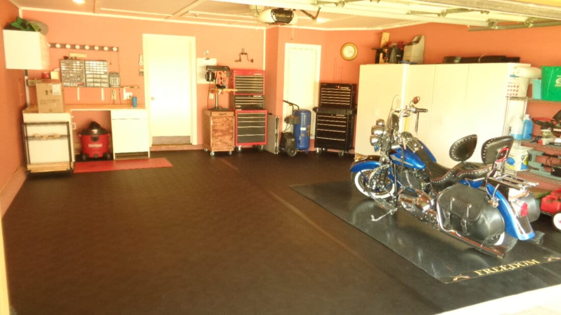 BLack BLT Rollout Flooring with motorcycle