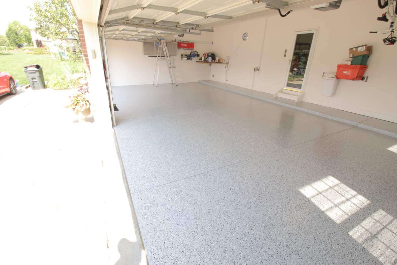 Garage flooring ideas from for Cost to level garage floor