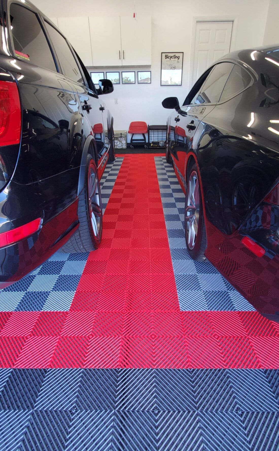 Ribbed garage floor tiles with black cars